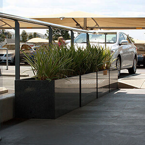 stone trough planter: IOTA Granite Planters at Parking Area