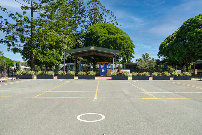 school parking lot with planters