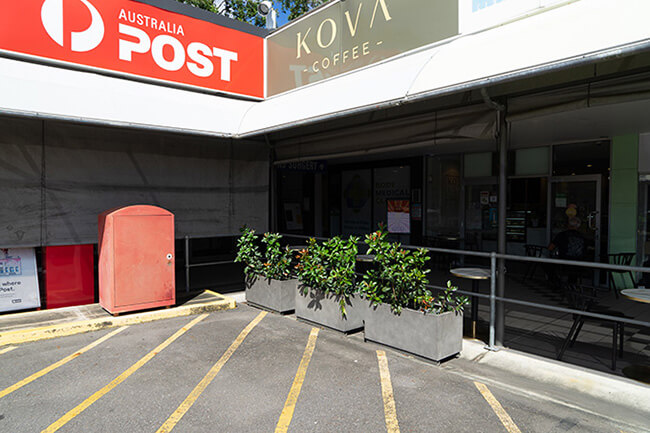 concrete rectangular planters at kova coffee and post office