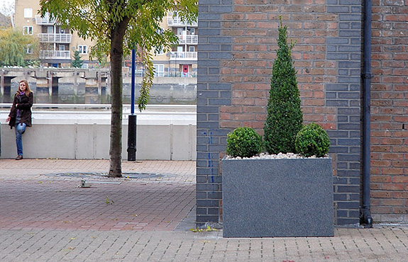 Granite trough planter with a view of the Thames
